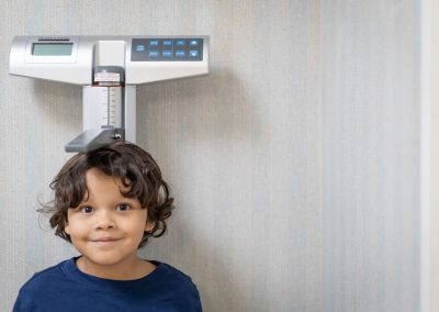 preschool pediatric services - child standing on scale